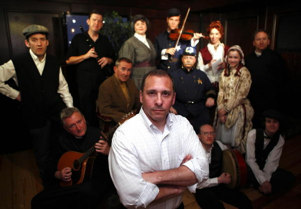 "Writer and producer Adam Whiteman, center, with the cast and band of his new show ""Music Mad"" at Chief O'Neill's Pub."