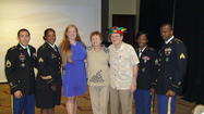 Local recruiters, Mardi Gras'  Laura Powell and Treats for Soldiers leaders at presentation.