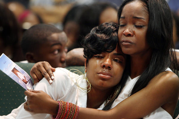 Ken McRoyal's sister Kenesha, left, is consoled by his girlfriend, Latrese Williams, during his memorial service at Mission Ebenezer Family Church in Carson. McRoyal was fatally shot on Mother's Day.