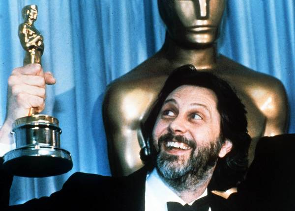 "Britain's David Putnam holds up his Oscar after the 1981 film ""Chariots of Fire"" was named best picture on March 30, 1982."
