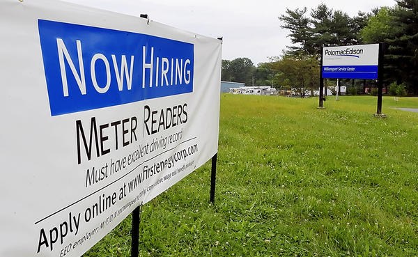 "A ""Now Hiring"" sign outside the Potomac Edison location on Bowers Ave."