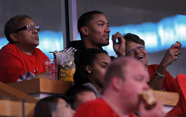 Derrick Rose watches his team play the 76ers in Game 2.