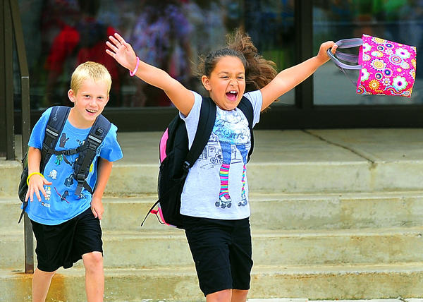 Delaney Joia exults Friday when released from her second-grade school year at Fountain Rock Elementary School. Fellow second-grader Ethan Teague seems happy, too.