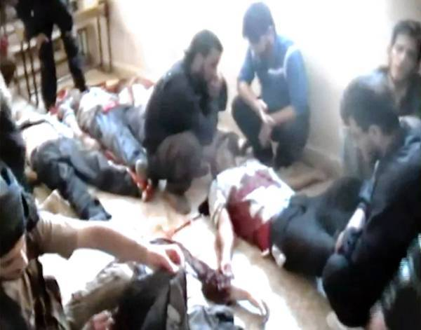 This image from an amateur video released by the Shaam News Network purportedly shows bodies of Syrian factory workers who were apparently killed execution-style near Qusair, in the central province of Homs.
