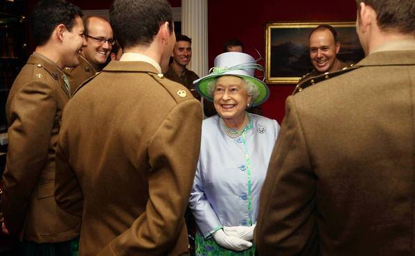 Britain's Queen Elizabeth II talks with officers at an event with the Argyll and Sutherland Highlanders, 5th Battalion, the Royal Regiment of Scotland in London on May 30, 2012. The queen keeps a busy schedule of public appearances.