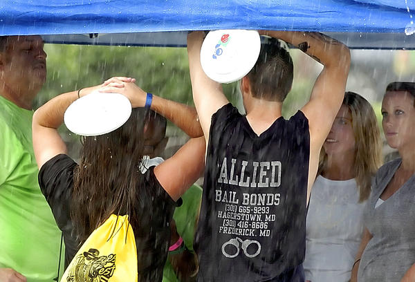 Frisbees were used to cover from the rain at Friday night's Blues Fest.