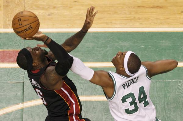Boston Celtics' Paul Pierce (34) guards Miami Heat's LeBron James (6) during the first quarter in Game 3 of their Eastern Conference Finals NBA basketball playoffs in Boston, Massachusetts June 1, 2012.