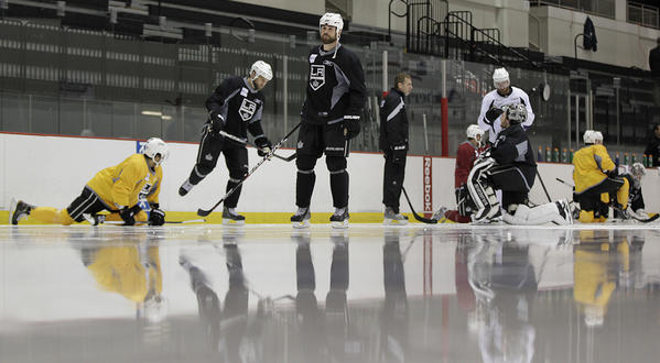 Kings defenseman Willie Mitchell, center, and his teammates warm up on the ice prior to the start of a team practice session Friday at the Prudential Center in Newark, N.J.