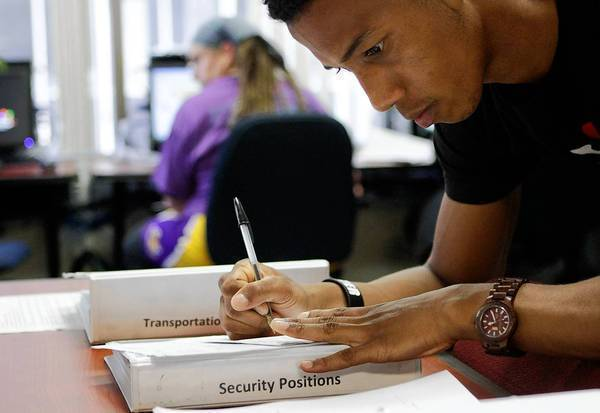 Andy Rolando looks for job employment opportunities at Goodwill's Wilshire Metro WorkSource center in L.A. The social services agency offers job listings and employment services.