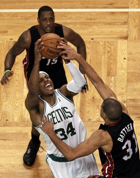 Boston Celtics' Paul Pierce (34) drives to the net on Miami Heat's Shane Battier during the third quarter in Game 3 of their Eastern Conference Finals