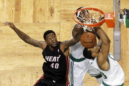 Boston Celtics' Ryan Hollins (R) battles for the ball with Miami Heat's Udonis Haslem during third quarter in Game 3 of their Eastern Conference Finals
