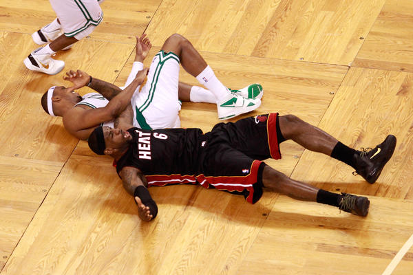 LeBron James #6 of the Miami Heat and Paul Pierce #34 of the Boston Celtics react as they fall to the court in the second half in Game Three of the Eastern Conference Finals