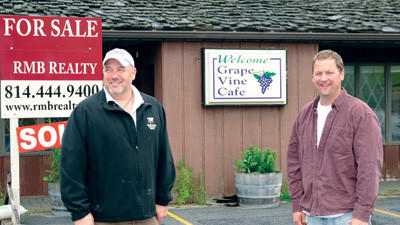 Jeff Latuch, left, and Jay Fisher are the new owners of the Grapevine Cafe property in Somerset Township. They plan to demolish the building and construct a new one that will house a restaurant and sports bar called Tailgatez.