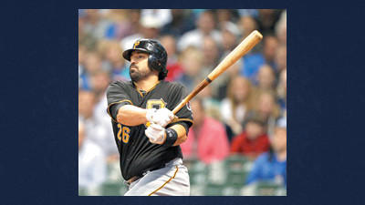 Pittsburgh Pirates' Rod Barajas watches his RBI-double against the Milwaukee Brewers during the third inning of a baseball game on Friday in Milwaukee.