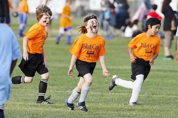 Aidan Gassel, middle, yells after scoring Newport Elementary's first goal against Sonora in a boys' 3-4 bronze division game at the Daily Pilot Cup.