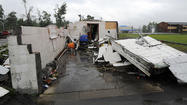An intense, widespread storm system spawned at least one tornado Friday and battered parts of the Baltimore region with damaging winds and torrential rain, halting flights and flooding roads during rush hour.