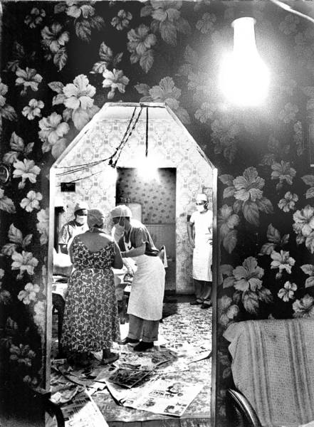 A team from the Chicago Maternity Center delivers a baby at a home in 1955. Doctors and nurses with the center, opened decades earlier by Dr. Joseph DeLee, often used newspapers to help provide a cleaner setting.