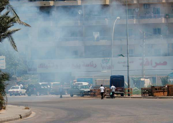 Smoke from clashes rises near the Sunni Muslim Bab al-Tebbaneh neighbourhood in Tripoli, northern Lebanon.