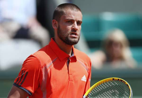 Russia's Mikhail Youzhny reacts during a match with Spain's David Ferrer hits a return to during their Men's Singles third Round tennis match of the French Open tennis tournament at the Roland Garros stadium, on June 2, 2012 in Paris.