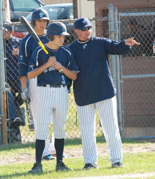 Petoskey High School baseball coach Shawn Racignol (right) and his Northmen were rained out of their district tournament on Saturday in Sault Ste. Marie. The tournament, along with many others involving area schools, has been rescheduled for Monday, June 4.