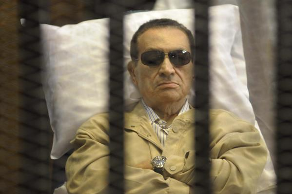 Former Egyptian President Hosni Mubarak sits inside a cage in a courtroom in Cairo June 2, 2012. An Egyptian judge convicted Mubarak of complicity in the killings of protesters during the uprising that ended his 30-year rule and sentenced him on Saturday to life in prison.