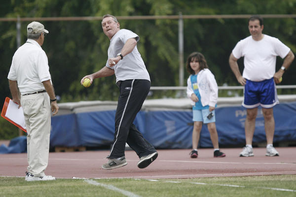 Robert Morris, from second left, participates in the softball throw event during 2012 Pasadena Senior Games, which took place at Caltech in Pasadena on Saturday, June 2, 2012.