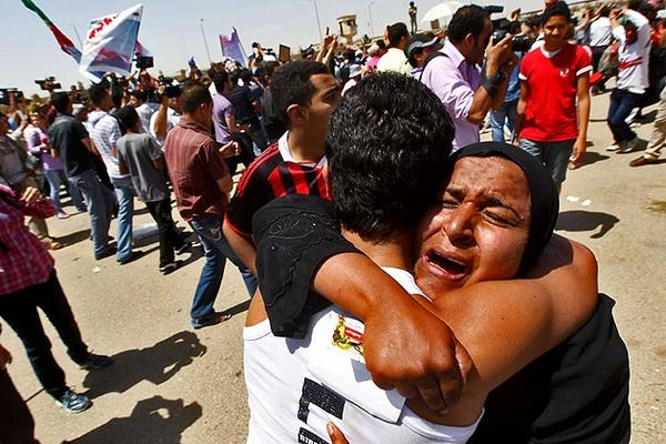 Relatives of protesters who were killed during the revolution last year react after hearing news of the verdict against former President Hosni Mubarak outside the courthouse in Cairo.
