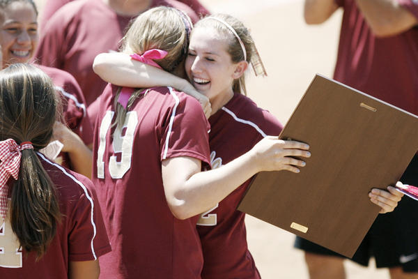 La Canada's Lauren Cox, left, and Catherin Homer, embrace each other after winning the CIF Southern Section Division V championship game against Beumont, which took place at Deanna Manning Stadium in Irvine on Saturday, June 2, 2012.