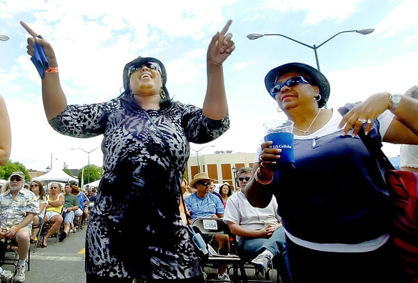 Marie Messick, left, of Martinsburg and her friend Cynthia Randolph of Gainesville, Ga., dance to the music at the Blues Fest Saturday.