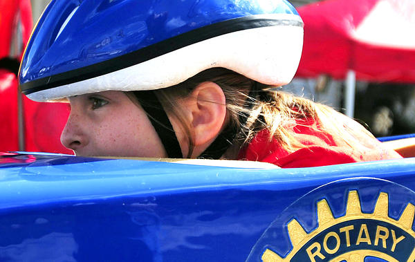 Grace Gregory, 9, of Big Cove Tannery, Pa., gets set for her first time driving a stock car in the All-American Soap Box Derby in Hancock Saturday.