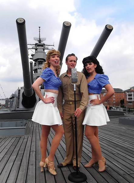 "Lindsay Eure, Danny Gardner and Gabriella Gomez perform in ""Swingtime Salute"" on the deck of the Battleship Wisconsin opening May 31 in Norfolk"