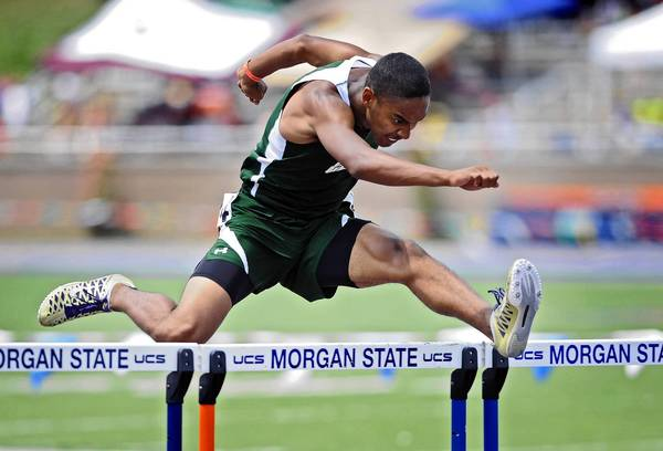 Julian Woods, of Century High, clears the last hurdle to win the Class 2A 300-meter hurdles at Maryland track meet finals at Morgan State University.