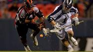 Midfielder Steven Brooks scored the tying and winning goals Saturday night to lead the Chesapeake Bayhawks past the host Denver Outlaws, 18-16, and into a first-place tie with the Boston Cannons in Major League Lacrosse.