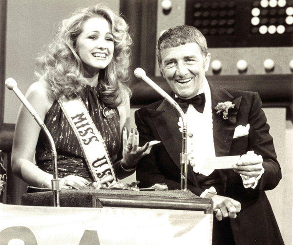 Actor, comedian and game show host Richard Dawson, pictured here with 1980 Miss U.S.A. Jineane Ford of Arizona, died at age 79.