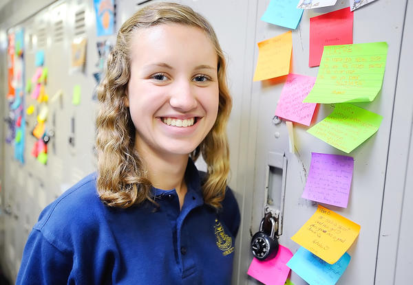 Saint Maria Goretti junior Jessica Swarner started the school's Positivity Club, and classmates now post positive post it notes on the lockers of fellow students.