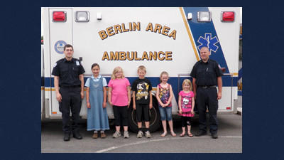 Winners of the Berlin Area Ambulance Association poster contest pose for a photo. From left is Seth Forry, Berlin Area Ambulance assistant manager; Ava Walker, fourth-grade winner; Nina Garber, third-grade winner; Austin Glessner, second-grade winner; Peyton Grenke, first-grade winner; Katie Beam, kindergarten winner. Kris Wyant, Berlin Area Ambulance manager is pictured at the far right.
