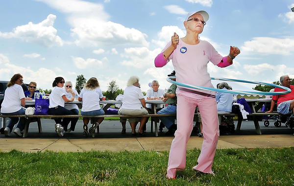 Breast cancer survivor Betty Ryan, 70, of Hagerstown hula hoops at a picnic for cancer survivors at the The Improved Order of Red Men's grounds off Lappans Road near Williamsport.