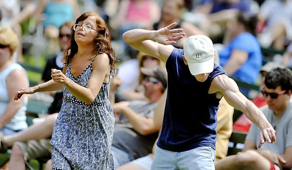 Anne Eden of Martinsburg, W.Va., and Darrell Hull of Hagerstown dance to the music at the Family Blues Picnic at City Park on Sunday.