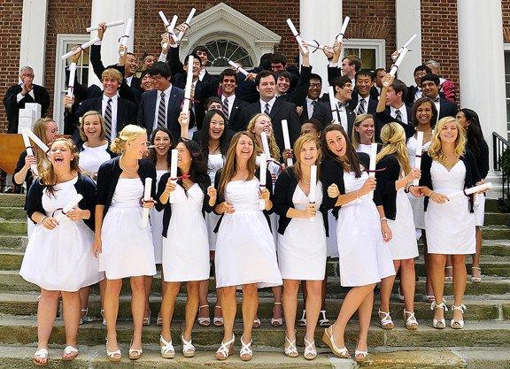 Saint James School graduates celebrate after receiving diplomas Sunday during the school's commencement ceremony. Thirty-nine students graduated.