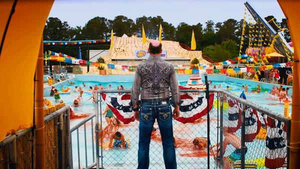 "David Koechner in the movie ""Piranha 3DD."""