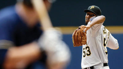 Pittsburgh Pirates starting pitcher James McDonald throws during the first inning of a baseball game against the Milwaukee Brewers on Sunday.