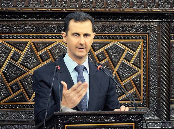 President Bashar Assad speaks before parliament in Damascus about the massacres in Syria.
