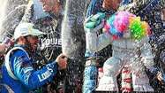 DOVER, Del. - Jimmie Johnson, who is used to being in fast company, joined a special group Sunday.