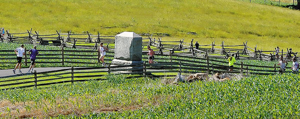 Runners make their way through Antietam National Battlefield during the Run Through History 10K on Sunday morning.