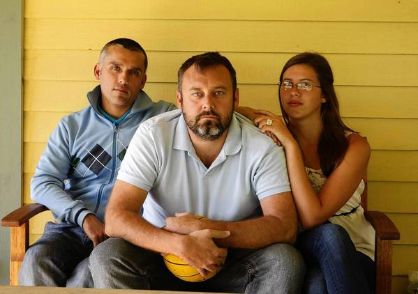 "Mitch Stein, who used to be an assistant water polo coach at Charter Oak High School, is flanked by his partner, Hugo Horta, and daughter Devynn. His wrongful termination suit accuses the school district of ""animus toward gay and lesbian employees."""