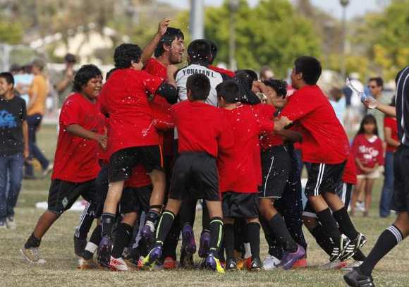 Members of the Pomona boys' 5-6 gold division team celebrate after winnings its first gold division title at the Daily Pilot Cup.