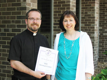 "The National Catholic Band Association awarded the Newman Center with the ""Friend of the Band Award"" for support of the band department at Aberdeen Roncalli. Receiving the award is the Rev. Tom Anderson, left, with Roncalli band director Kimberly Carda."