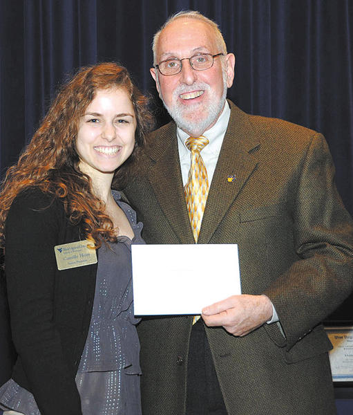 Camille Heim, left, is presented the Frank W. Vigneault Memorial Scholarship by Arthur Jacknowitz, professor, Department of Clinical Pharmacy, West Virginia University School of Pharmacy.