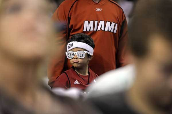 Miami Heat fan Ricardo Rios, 6, from Miami doesn't like to see the Heat trailing the Boston Celtics during the first half of Game 3 of their Round 3 playoff series, Friday, June 1, 2012, at TD Garden.