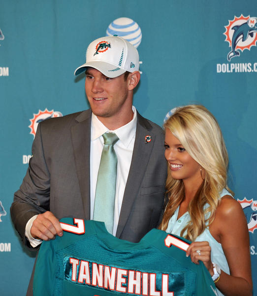 "Miami Dolphins first round draft pick quarterback <a class=""taxInlineTagLink"" id=""PESPT0014998"" title=""Ryan Tannehill"" href=""/topic/sports/football/ryan-tannehill-PESPT0014998.topic"">Ryan Tannehill</a> (Texas A&M) holds up a jersey next to his wife Lauren Ufer during a press conference at the Dolphins training facility."